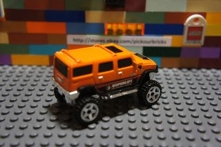 Hot Wheels Orange Hummer H2 HW Performance '12 10 10 Diecast Vehicle